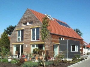 "This ""passive house"" in not so sunny Germany uses high performance windows, very tight construction, super-insulation, and a ventilation system that keeps interior air fresh without losing much heat or cool.  Sunlight, heat from appliances, and people keep these houses warm on all but the coldest days and cool in the summer.  Using passive houses in the US would slash heating and cooling costs by 80% or more."