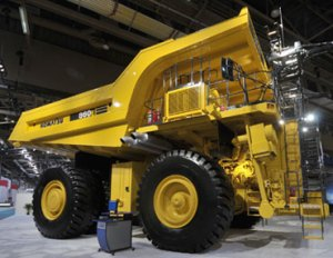 Some immense off road machines like this mining truck or tunnel boring machines use grid electricity but move fairly slowly or over well-defined paths.  For mobile machines building the electric energy infrastructure we need, using compressed natural gas may be one cleaner alternative to diesel.